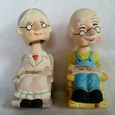 "New ListingBobblehead Piggy Bank Grandparents in Rockers w/ Spectacles Approx 7¼"" Tall"