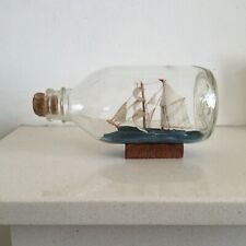Vintage Wooden Model Ship in a Bottle on a Wooden Plinth with Stopper