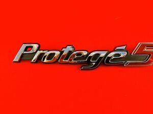 2002-2003 MAZDA PROTEGE5 EMBLEM REAR TRUNK OEM BADGE