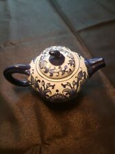 White China Teapot with Dark Blue Handle, Spout, & Leafy Design with Lid