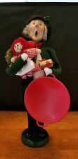 Byers Choice The Carolers: Man Shopper with Red Snow Disc, Wreath, Doll and Gift