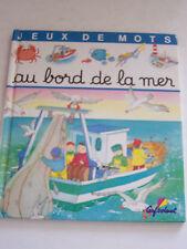 JEUNESSE , JEUX DE MOTS AU BORD DE LA MER  . BEAU LIVRE POUR ENFANTS .