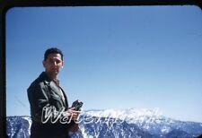 1950s red border  kodachrome Photo slide   man with movie camera