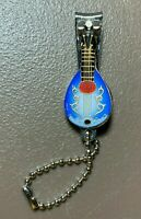 Vintage 70's 80's Enameled Guitar Nail Clippers Keychain in Electric Blue
