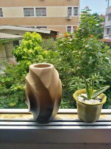 Wooden spiral design vase from mango tree
