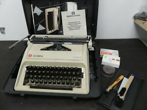 (Ref288) Olympia Carina 2 Typewriter and accessories