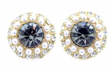 Small, elegant crystal stud earrings embedded with a ring of tiny pearls