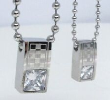 "String fellow ""Checkerboard"" stainless steel. 2 silver pendant couple"