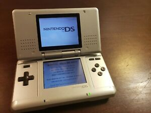NINTENDO DS Preowned Silver Handheld Tested. No Charger