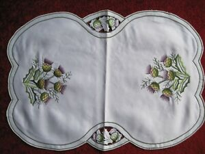 """A PLACEMAT 17.5"""" x 12"""",  THISTLE EMBRODERED DESIGN ON IVORY SATIN LIKE MATERIAL."""