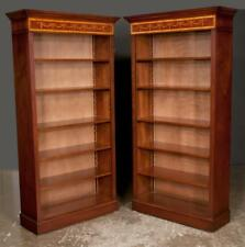 Pair of Sheraton style mahogany open bookcases with ribbon and bell f. Lot 134