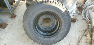 WHEEL AND TYRE ASSEMBLY (SAND)  10.0/75 X 15.3  10PR DUMPER TRACTOR