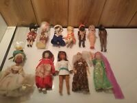 Lot of 12 vintage dolls, 1 porcelain , 1 old carnival doll , 1 Avlon, 1 NOS