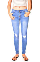 WAKEE BLUE MID RISE SKINNY LEG JEANS WITH RIPPED KNEE. SIZE 6-16