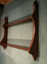 A mahogany/teak wall shelf unit, ideal for spice jars or small collectables