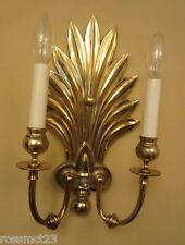 Dramatic pair of large gold sconces