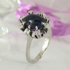 Ring in 585 Weißgold 14K mit 1 Saphir Cabochon + 8 Diamanten ca 0,16 ct Gr. 54