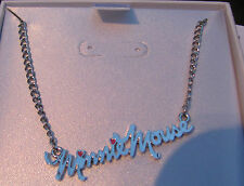 Genuine Disney Minnie Mouse silver necklace pendant with pink hearts.