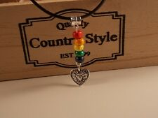 LGBT PRIDE Cord necklace with rainbow wood beads and filigree heart  51 cm cord