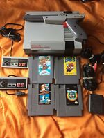 Nintendo Console NES-001 Bundle with 2 Controllers, Zapper, 4 Games, & Cables