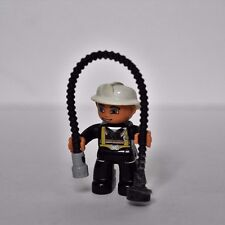 Lego mini figure Fireman with helmet and hose