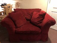 Oversized chair in deep maroon