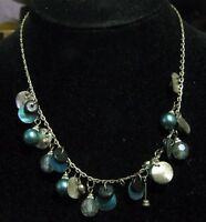 Pretty silver tone metal chain necklace with various beads and discs