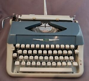 """1960's blue & cream colored """"Florida"""" portable typewriter cleaned, oiled, ribbon"""