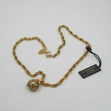 VINTAGE Chanel Gold Tone Necklace with Rhinestone Knot Charm Pendant NO BOX