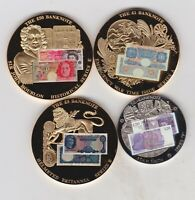 FOUR GOLD PLATED & SILVER PLATED MEDALS WITH BANKNOTE PAD PRINT DESIGNS.
