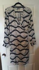 Vero Moda size L wrap dress with pockets in white