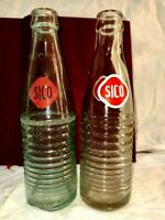 Old vintage two small bottle of seco drink bottle. Empty without breaking