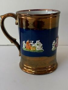 ANTIQUE STAFFORDSHIRE COPPER LUSTER MUG WITH BLUE BAND/RAISED WOMAN AND DOG