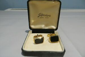 PAIR OF SELFRIDGES BLACK AND GOLD TONE CUFFLINKS BOXED