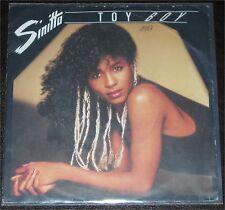 """Sinitta, Toy Boy, VG/VG++ 7"""" Single 0846-3"""