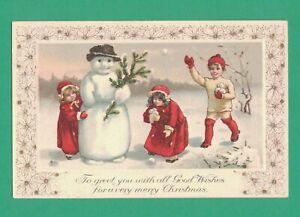 VINTAGE CHRISTMAS POSTCARD CHILDREN SNOWBALLS SNOWMAN HAT FIR BRANCH