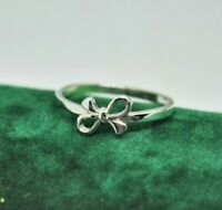 Vintage Sterling silver ring with a gift bow design size Q #P733