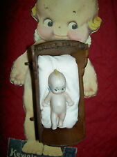 Antique German bisque Kewpie doll c1913 Rose O'Neill reclining in wooden cradle