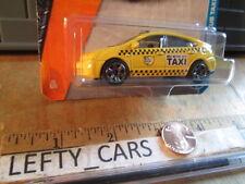 MATCHBOX TOYOTA PRIUS TAXI Yellow 4door Car SCALE 1/64 Long Card - NEW!