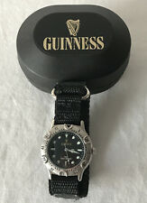 GUINNESS WATCH in Plastic Guinness Case - New Battery.  Cloth Velcro Strap