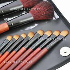 Brochas, pinceles, aplicadores de maquillaje en negro