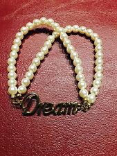 Girls Bracelet With Pearl Type Beads And The Word Dream In Silver