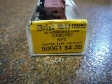 N SCALE MICRO-TRAINS NYC 19559 34' WOOD SHEATHED CABOOSE Rapido - Type Coupler