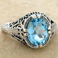 925 Sterling Silver Ring Size 7.75, #691 2 Ct Genuine Blue Topaz Antique Design