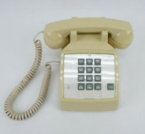 Cortelco 250044-VBA-27F Yellow Old Vintage Dial Phone 2500