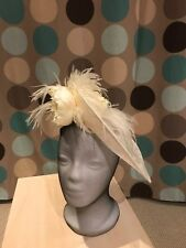fascinator, cream with flowers and feathers