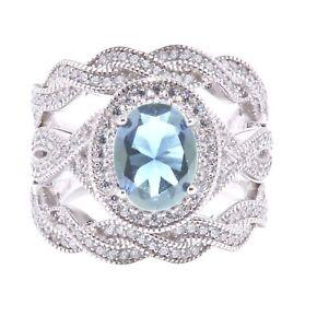 Large Halo Oval Aquamarine Infinity CZ Silver Wedding Engagement Three Ring Set