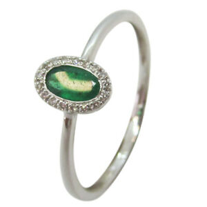 9ct White Gold 0.25ct Oval Emerald and Diamond Halo Dress Ring