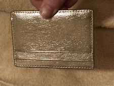 Kate Spade metallic gold leather card holder never used
