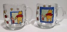 """Disney Winnie the Pooh """"It's Friendlier with two"""" Clear Glass Mugs Lot of 2"""